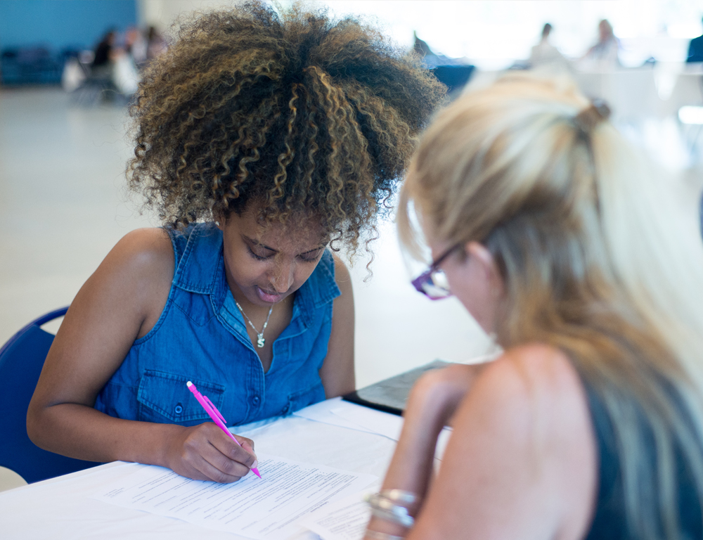 A female student at UNH gets help on her resume