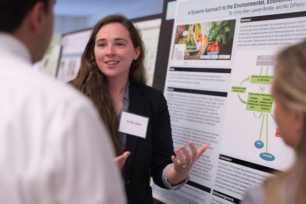 A female student presents her poster on local food