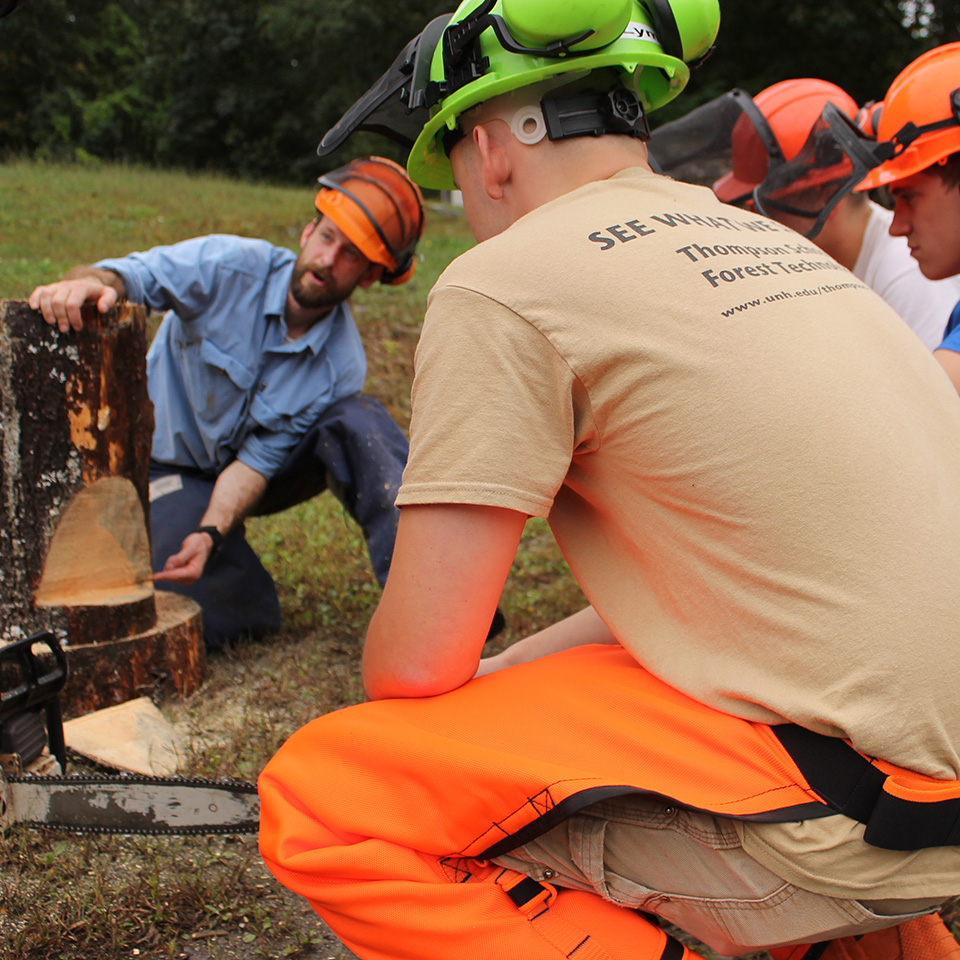 Mike Simmons teaching about cutting logs