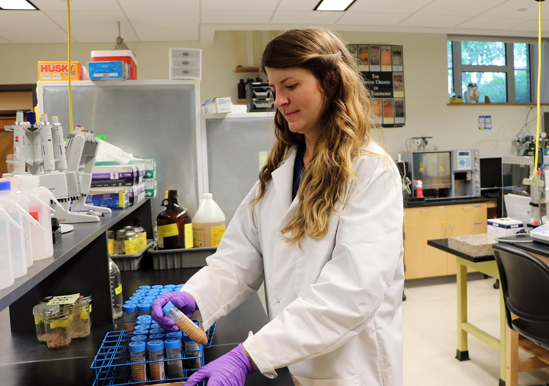UNH Doctoral Candidate Andrea Jilling at Examines Samples