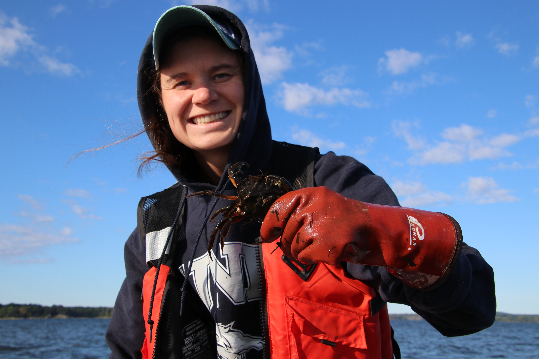 Kelsey Meyer holding green crab