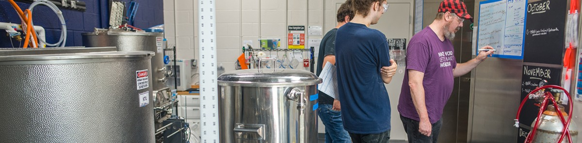 Students planning brew schedule