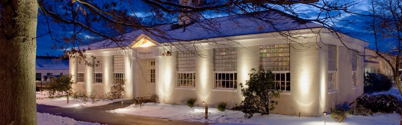 Putnam Hall at night in winter