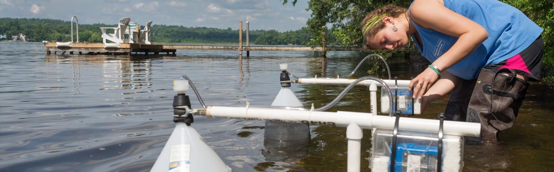 Female student calibrating water testing equipment