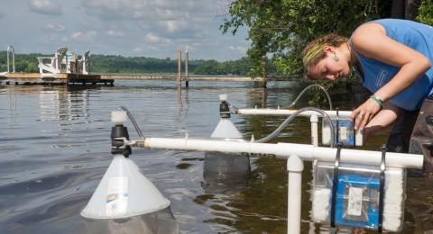 Student calibrating water testing equipment