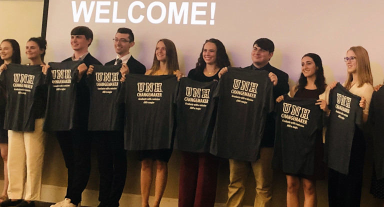 UNH social innovation interns show off their changemaker t-shirts