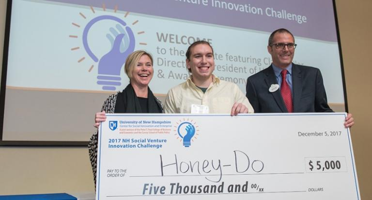 Honey-Do's Andrew Demeo and Jessica Waters pose for a photo with an award check.