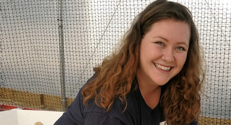 Ashley Bruns cares for chicks
