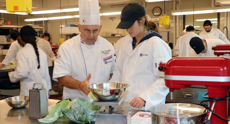 Professor Charlie Caramihalis instructs a student enrolled in the culinary nutrition and food studies minor