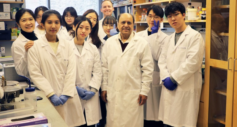 Professor Minocha poses with the eight students from South Korea