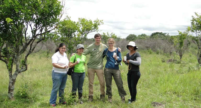 A field team of five people holding their ladybug collecting jars.