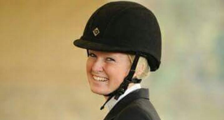 A headshot of Sian Mooney, in a riding helmet and jacket.