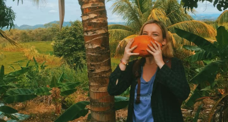 Taylor Zupo drinks fresh coconut water in Peru.