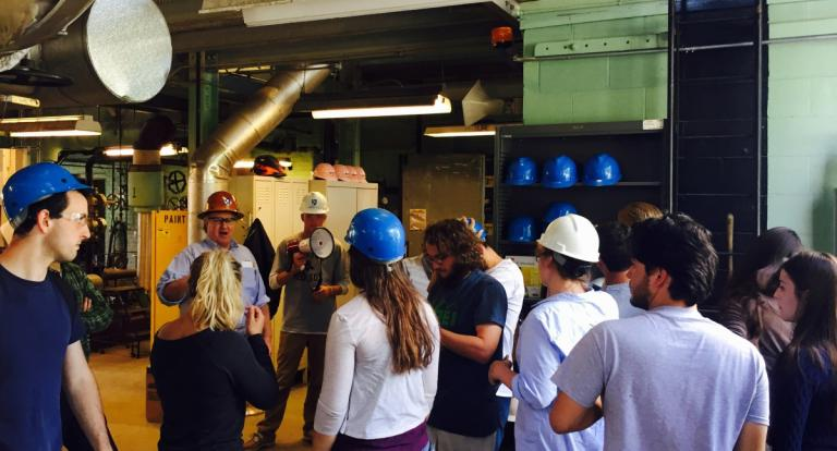 A group of students wearing hard hats on a tour of the UNH Cogen Plant.