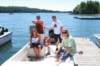grad students in boat researching water pollution