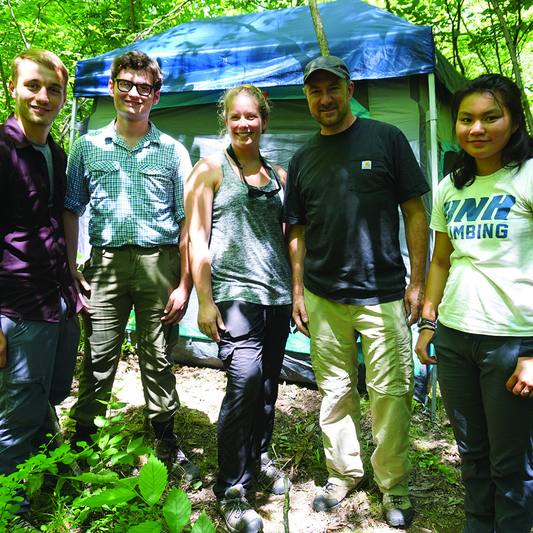 UNH Assistant Professor Jeff Garnas and his research team